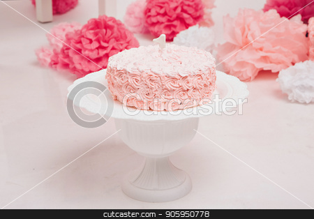 pink cake of flowers on a white stand, around pink flowers and balls stock photo, pink cake of flowers on a white stand, around pink flowers and balls by aaalll3110