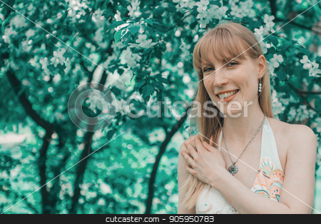 Portrait of a girl on a background of green foliage stock photo, Portrait of a girl on a background of green foliage by aaalll3110