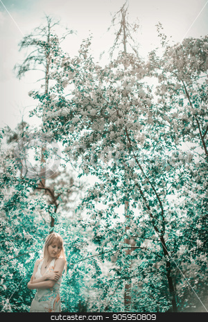 young woman in forest on a background of green foliage stock photo, young woman in forest on a background of green foliage by aaalll3110