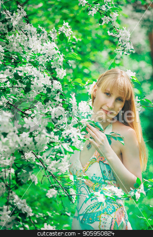 Portrait of a girl on a background of green foliage. weekend in nature stock photo, Portrait of a girl on a background of green foliage. weekend in nature by aaalll3110