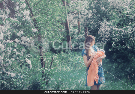 Portrait of a girl with baby on a background of green foliage stock photo, Portrait of a girl with baby on a background of green foliage by aaalll3110