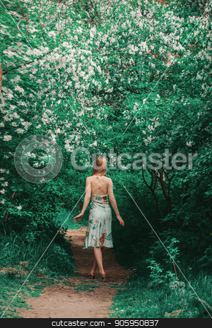 young woman in forest on a background of green foliage. Fashion for women stock photo, young woman in forest on a background of green foliage. Fashion for women by aaalll3110