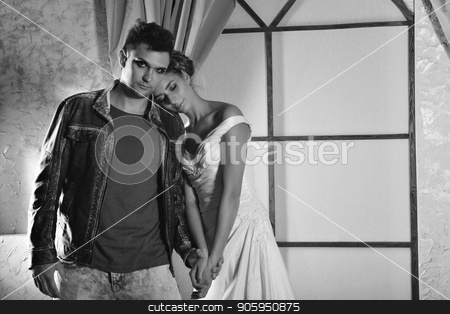 Painted guy hugs a girl in a white dress with a crown. Beauty and the beast these days. Portrait of man and woman stock photo, Painted guy hugs a girl in a white dress with a crown. Beauty and the beast these days. Portrait of man and woman by aaalll3110