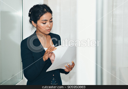 girl in a business suit Asian appearance on a white background in the office working with documents stock photo, girl in a business suit Asian appearance on a white background in the office working with documents by aaalll3110