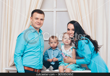 family portrait on the floor on white background stock photo, family portrait on the floor on white background by aaalll3110