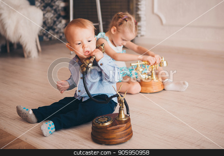 Children play with the phone on the floor. Business concept for beginners. Job interview. business negotiation stock photo, Children play with the phone on the floor. Business concept for beginners. Job interview. business negotiation by aaalll3110