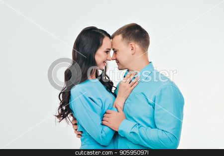 portrait of a man and a woman on a white background. Pair in blue stock photo, portrait of a man and a woman on a white background. Pair in blue by aaalll3110