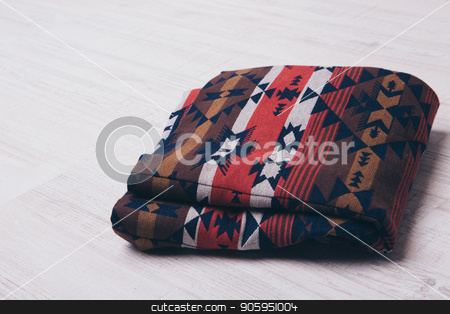 rolled up clothes made of natural fabric on white background. Elements of clothing close-up stock photo, rolled up clothes made of natural fabric on white background. Elements of clothing close-up by aaalll3110