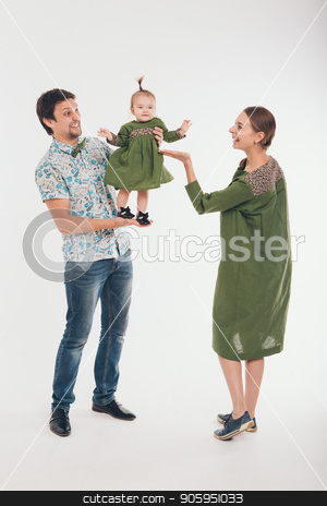 Family photo: mom, dad, child. Fashion in green and grey stock photo, Family photo: mom, dad, child. Fashion in green and grey by aaalll3110