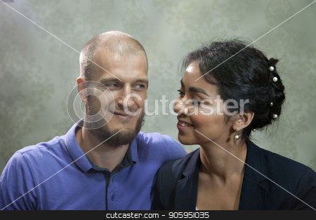 portrait of a man and a woman on a grey background. Pair in blue stock photo, portrait of a man and a woman on a grey background. Pair in blue by aaalll3110