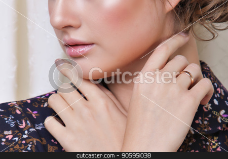 cropped photo: girl holding her hand near her face. Model posing in a dress. Item of clothing close-up stock photo, cropped photo: girl holding her hand near her face. Model posing in a dress. Item of clothing close-up by aaalll3110