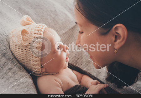 mother holds on the hands of his bare newborn baby. Woman with a baby in her arms. stock photo, mother holds on the hands of his bare newborn baby. Woman with a baby in her arms. by aaalll3110