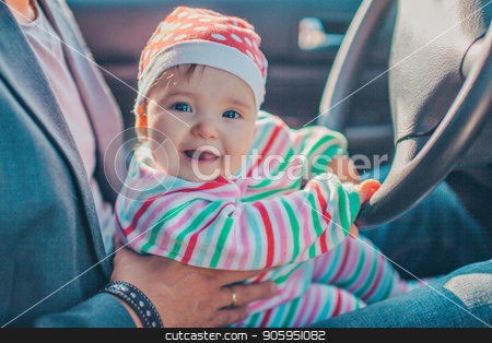 A little girl pretends to drive a car. Concept photo of children education, learning , drive a car,funny, happy, play, happiness, car insurance stock photo, A little girl pretends to drive a car. Concept photo of children education, learning , drive a car,funny, happy, play, happiness, car insurance by aaalll3110
