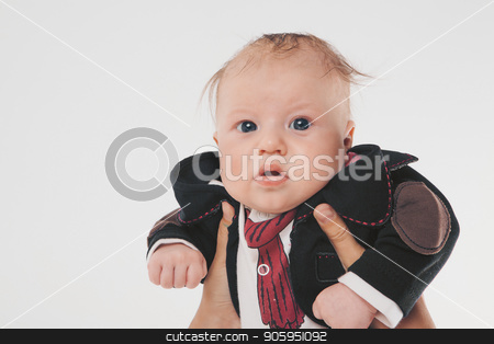 A little boy with black eyes in a business suit holding hands stock photo, A little boy with black eyes in a business suit holding hands by aaalll3110