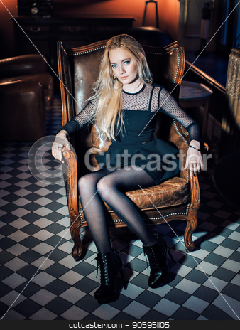Portrait of a blue-eyed blonde in black clothes. Beautiful girl looking at the camera. Woman with loose hair stock photo, Portrait of a blue-eyed blonde in black clothes. Beautiful girl looking at the camera. Woman with loose hair by aaalll3110
