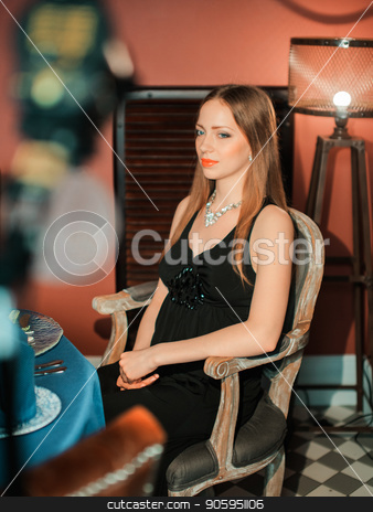 beautiful girl in a long red dress, sitting in a chair at the table stock photo, beautiful girl in a long red dress, sitting in a chair at the table by aaalll3110