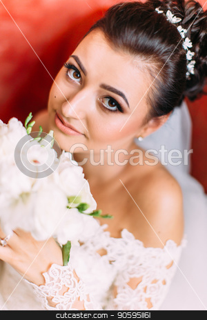 Close-up portrait of the bride with wedding bouquet of white roses. stock photo, Close-up portrait of the bride with wedding bouquet of white roses by Andrii Kobryn