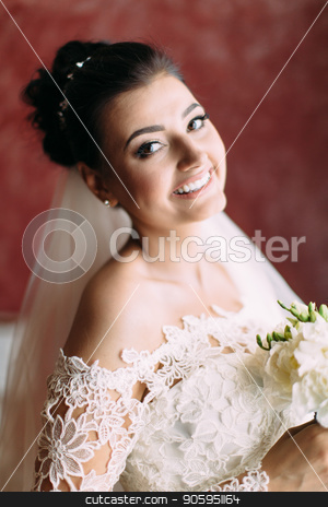 The smiling bride with the wedding bouquet of white roses. Close-up portrait. stock photo, The smiling bride with the wedding bouquet of white roses. Close-up portrait by Andrii Kobryn