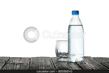 Empty glass and bottle of water stock photo, Empty glass and bottle of water. Plastic bottle on a wooden table. Isolated on white background. by Vitalii Borovyk
