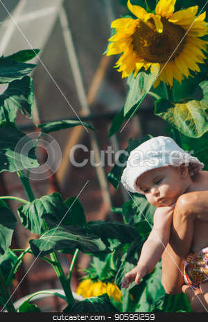 Portrait of a girl and baby with flower on a background of green foliage stock photo, Portrait of a girl and baby with flower on a background of green foliage by aaalll3110