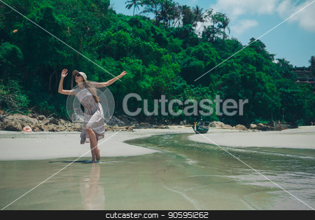 beautiful girl dancing on the beach. Portrait of a woman in white clothes on the sea. Dancer on the sand stock photo, beautiful girl dancing on the beach. Portrait of a woman in white clothes on the sea. Dancer on the sand by aaalll3110