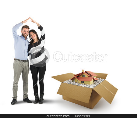 House in a cardboard box. Concept of buying a dwelling stock photo, Young couple of lovers wish to live together in a home by Federico Caputo