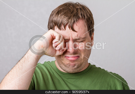 Aww poor little cry baby stock photo, Guy who is very upset for who knows what. He is just crying and making big baby sad faces. by txking
