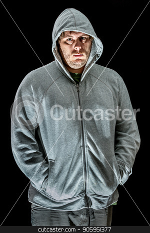 Young man with hands in sweater  stock photo, Looking into the camera the man is ready for whatever happens by txking