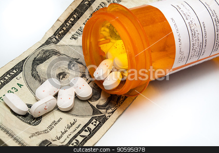 Bottle of prescription pills laying on money stock photo, Cost of drugs is going up and they are also finding their way on our streets due to addictions by txking