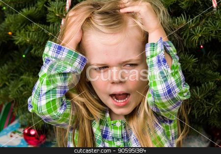 This is NOT what I wanted stock photo, Little girl quite unhappy and distraught over getting the wrong gift. by txking