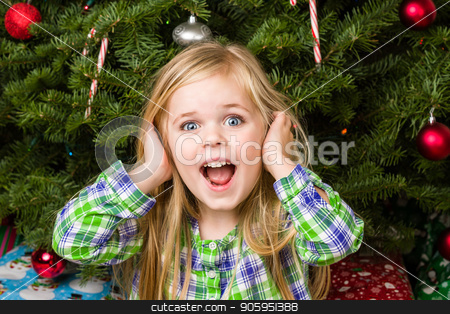 Kid is quite happy about her christmas stock photo, Her present was the best present ever and she is letting her parents know. by txking