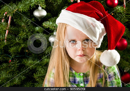 Sad little girl during christmas stock photo, She didn't get what she wnated for christmas and has a sad face. by txking