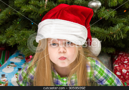 The dirty look at christmas stock photo, Young child giving a dirty look during christmas time. by txking