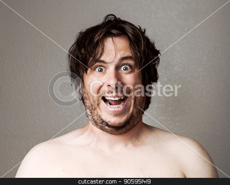Crazy Man looking at the camera stock photo, Topless man making a creepy looking smile at the camera against a lightly textured background by txking
