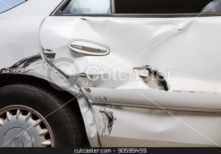 Profile view of a dented car with a hole stock photo, Car was crunched during an accident. Six month old child was behind door and survived with only minor scratches. Between the door and the car seat it protected the child from further harm by txking