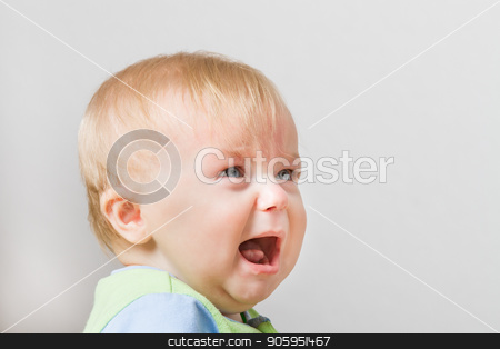 Boy looking up into space screaming stock photo, Crying boy around 7 months of age. Some space for your own text on the side by txking