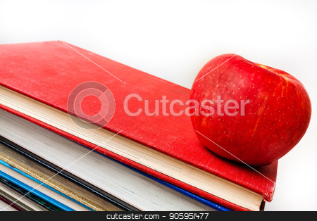 On to school stock photo, Well used books with an apple sitting on them by txking