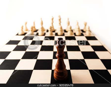 Single chess piece the King standing up against many of his enemies. stock photo, Black chess piece with a stretched perspective alone up against many white pieces. can stand for racism, challenge, adversity, diversity, courage,  or many other challenges in life. by txking