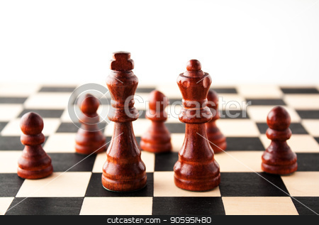 King and Queen in front of their royal subjects the pawns. stock photo, Multiple concepts ranging from marrige, power, family life, stratagy, or just royalty and chess available by txking