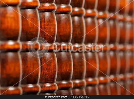 Pattern of wooden bars stock photo, A image with shallow depth of field showing a set of nice hard redwood bars. by txking