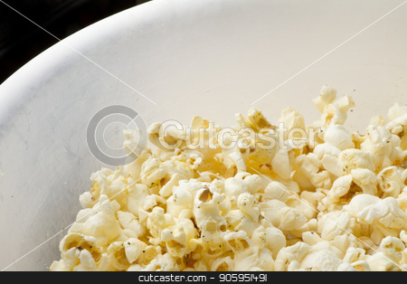 Popcorn in a bowl stock photo, bowl of popcorn with some empty black space in upper left corner by txking
