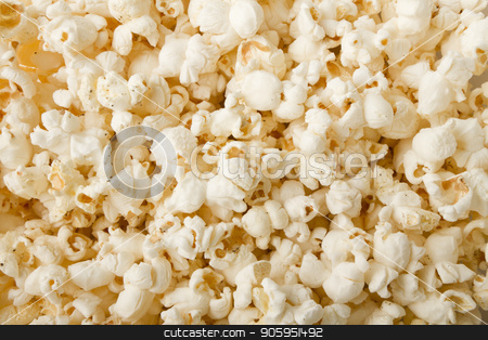 Puffs of good buttered popcorn stock photo, close up of popcorn with salt and pepper and lightly buttered and ready for a movie by txking