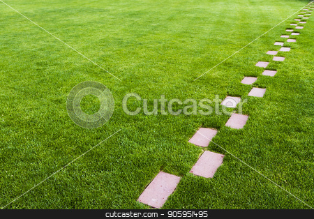 Stone pathway in the grass stock photo, Pathway of stone bricks leadin up and away at an angle in a grass field. Who knows where it leads? by txking