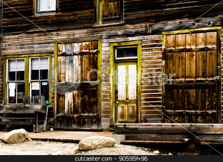 Old store front from the wild west days stock photo, Wooden storefront of an old mining ghost town that is weathered. by txking