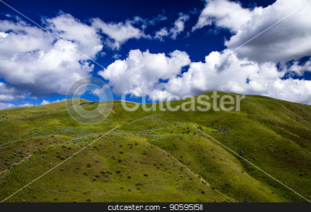 colorfull mountains stock photo, rolling hills with a deep blue sky in the background by txking