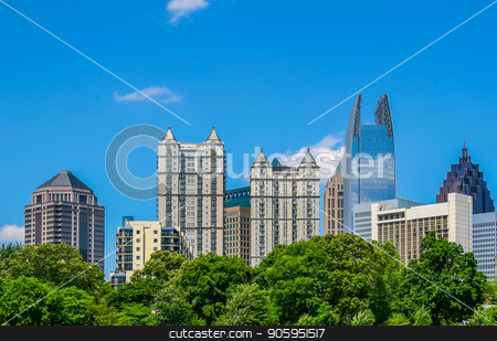 Condos Near Park stock photo, Modern condo towers rising from the trees by Darryl Brooks