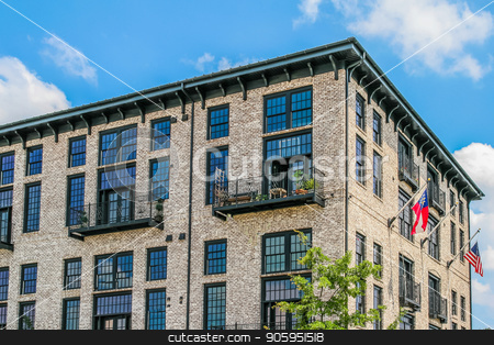 Brick Loft Building stock photo, Old style loft apartments in the city by Darryl Brooks