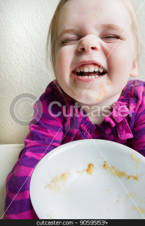 Child finished with her bowl of healthy food and a messy face stock photo, High key tight cropped shot of a single child making a funny smily face when she finished her food by txking