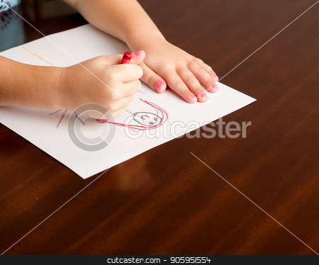 Child drawing a little person stock photo, Image of a childs hands, a crayon, and paper on a table while she is creating her masterpiece by txking