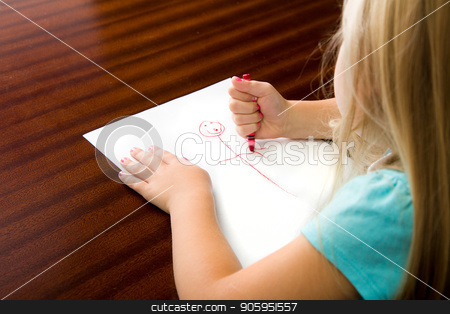 What is she drawing stock photo, Behind the child as she is drawing her next masterpiece. by txking